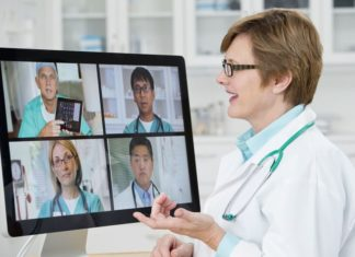 Doctors-talking-in-video-conference-in-hospital-Ariel-Skelley-Blend-Images-Getty-5817aded5f9b581c0ba23beb